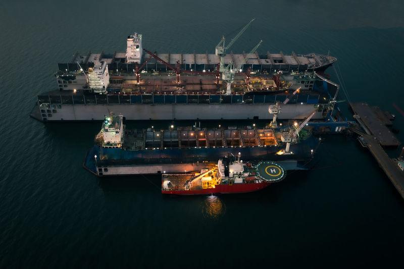 High angle view of illuminated ship moored at harbor