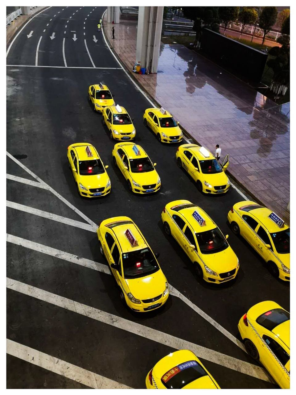 transportation, high angle view, yellow, car, road, mode of transportation, motor vehicle, road marking, sign, symbol, marking, street, no people, land vehicle, city, day, transfer print, taxi, auto post production filter, traffic, outdoors