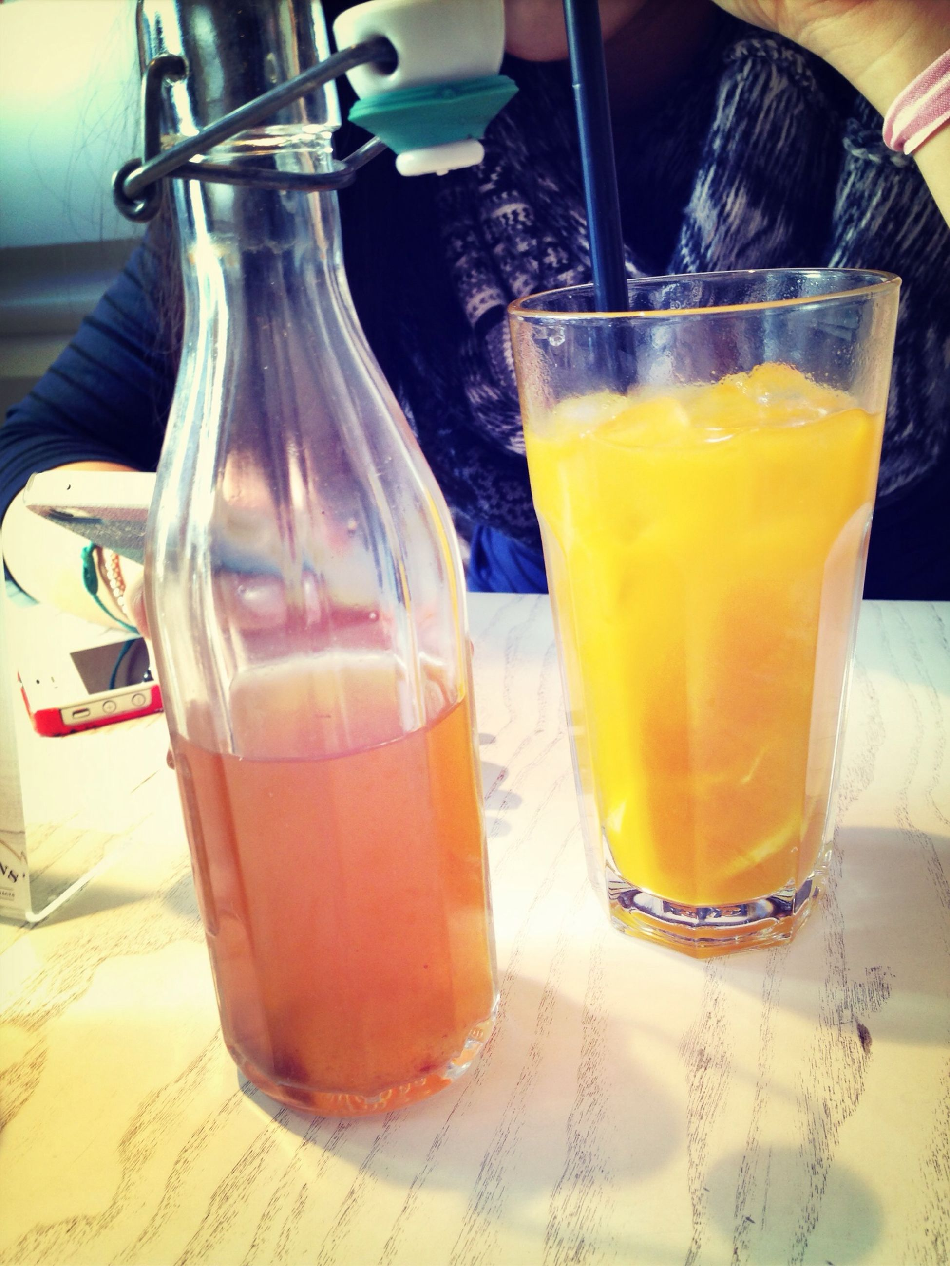 drink, food and drink, refreshment, table, drinking glass, indoors, still life, drinking straw, freshness, alcohol, juice, glass - material, close-up, glass, cocktail, restaurant, transparent, yellow, focus on foreground, no people