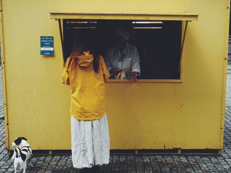 kiosk in the city of Mandal, Norway Mandal Sørlandet Houses Building Exterior Architecture Built Structure Women Outdoors Norwegian Summer Adults Only Adult People Kiosk Shopping Dog People And Places Pet Portraits Paint The Town Yellow Paint The Town Yellow