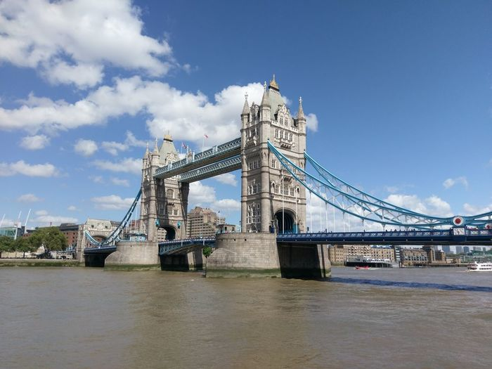 Tower bridge over thames river against sky