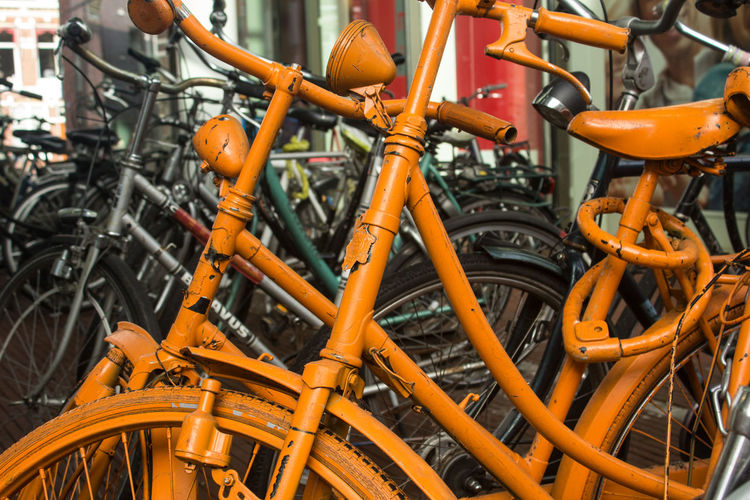 Paint Statement Transport Bicycle Bicycle Rack Close-up Day Mode Of Transport No People Orange Color Outdoors Ride Transportation