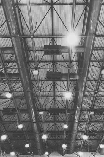 Aim for the sky so you can reach the ceiling.✨ Industrial Indoors  Light And Shadow Light Challenge Ceiling 7 Day Black And White Photo Challenge Black And White Collection  Blackandwhite Photography Blackandwhite Eyeemphotography EyeEm Selects EyeEm Gallery EyeEmNewHere EyeEm Best Shots Iphonesia Iphonephotography Iphoneonly IPhoneography Low Angle View Lens Flare Illuminated No People Architecture EyeEmNewHere