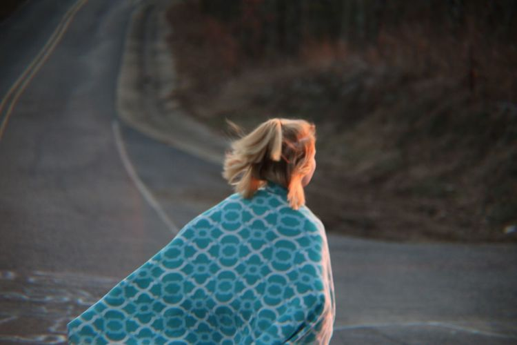 Rear view of woman with shawl