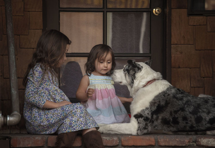 Innocence Casual Clothing Child Childhood Children Photography Dog Dog Love Domestic Animals Family Females Girls Lifestyles Real People Two People Warm Colors Women