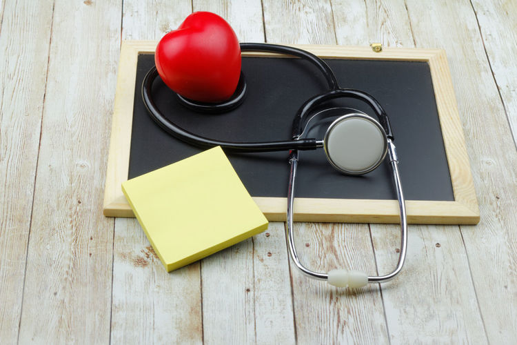Health concept Adhesive Note Sticky Note Heart Love Heart Shaoe Stethoscope  Copy Space Copyspace Wooden Background Blackboard  Concept Conceptual Medical Background Studio Shot Red Wood - Material Preparation  Close-up Note - Message Office Supply