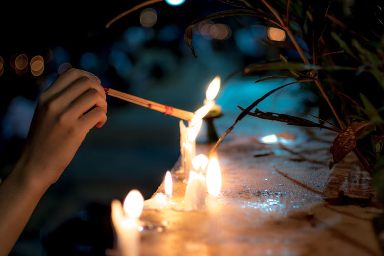 Human Hand Human Body Part Flame Fire Burning Real People Hand Holding Illuminated One Person Motion Finger Lifestyles Human Limb Unrecognizable Person Body Part Leisure Activity Incense