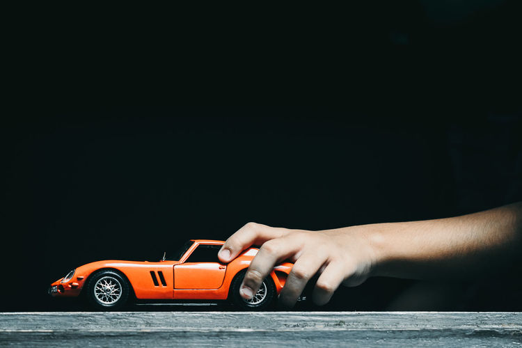 Ferrari Playtime Toy Car Black Background Car Care Childhood Close-up Finger Hand Holding Holding A Toy Car Human Hand Indoors  Studio Shot Toy Toy Car The Still Life Photographer - 2018 EyeEm Awards