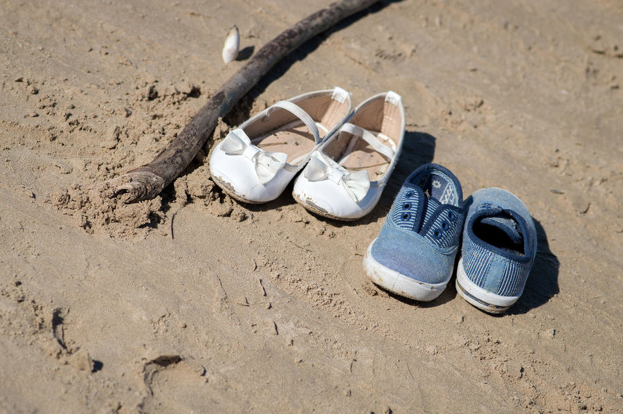 Children footwear at the beach on sand on a summer day Beach Blue Sky Children Close-up Day Elegant Footwears High Angle View Holidays Nature No People Outdoors Pair Sailing Sand Shoe Sneakers Summer Vacation White Color Sommergefühle The Still Life Photographer - 2018 EyeEm Awards