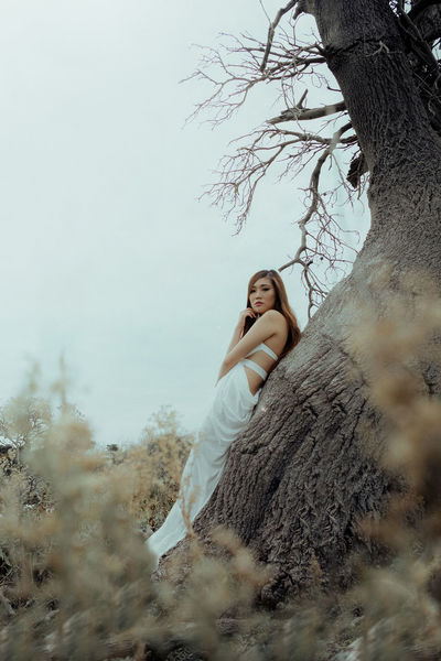 Bare Tree Beautiful Woman Beauty In Nature Branch Day Full Length Girl Leisure Activity Lifestyles Looking At Camera Nature One Person Outdoors People Portrait Portrait Of A Woman Portraits Real People Sky The Portraitist - 2017 EyeEm Awards Tree Women Women Around The World Young Adult Young Women