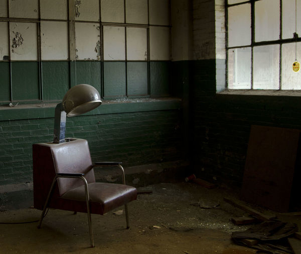 Old hair dryer chair in abandoned factory