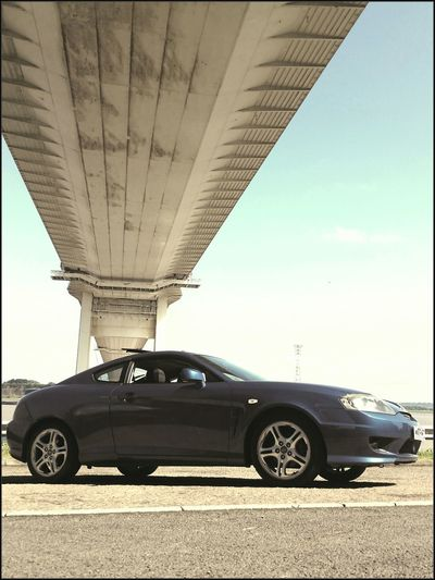 Taking Photos Love My Car Under The Bridge Severn Bridge England Wales Border Meinautomoment Car Porn Hyundai Coupe Road Crossing I Love My Car