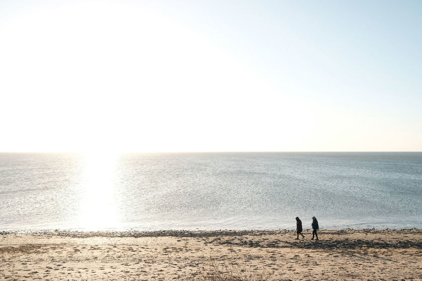 Land Sea Water Horizon Beach Two People Horizon Over Water Sky Copy Space Nature Togetherness Sand Standing Tranquil Scene Tranquility Scenics - Nature Clear Sky Men Beauty In Nature Couple - Relationship Outdoors Positive Emotion