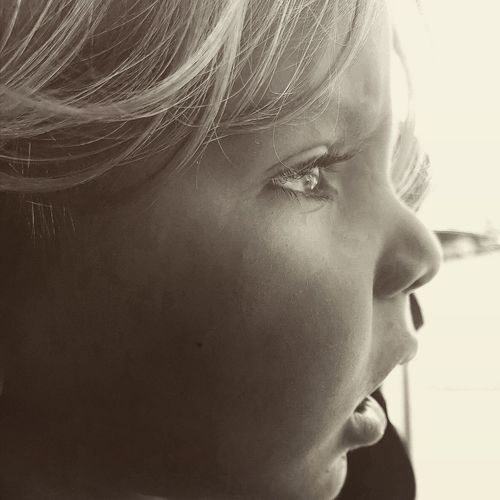 Close-up portrait of girl looking away