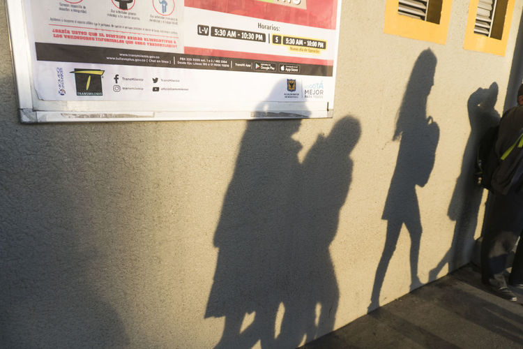 Shadow Sunlight Real People Group Of People Nature Men People Women City Transportation Adult Day Lifestyles Architecture Leisure Activity Built Structure Outdoors Street Standing Focus On Shadow