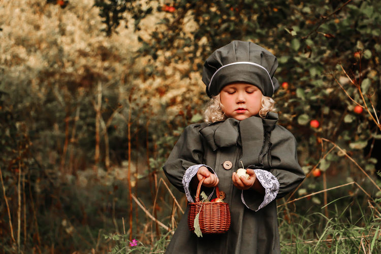 little girl in vintage English clothes in an old garden Males  Childhood Child Children Photography Looking At Camera Autumn colors Outdoors Food And Drink Forest