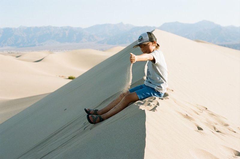 Rear view of boy on desert