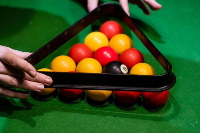Close-up Competition Day Green Color Human Body Part Human Hand Indoors  Leisure Activity Leisure Games Lifestyles Multi Colored One Person People Playing Pool - Cue Sport Pool Ball Pool Cue Pool Table Real People Snooker Snooker And Pool Snooker Ball Sport Table Unrecognizable Person