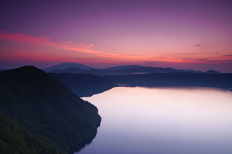 Scenic view of lake against sky at dawn