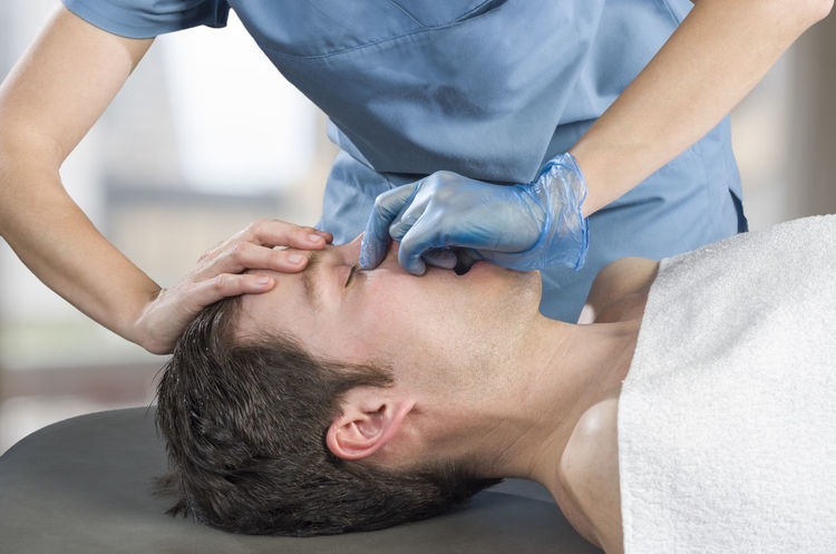 Physiotherapist, chiropractor doing a sinus massage, therapy. Osteopathy Back Doctor  Man Medicine Pain Therapy Woman Cervical Chiropractor Clinic Healthcare And Medicine Injury Manipulation Massage Medical Muscles Muscular Patient person Physiotherapy Professional Stretching Therapist