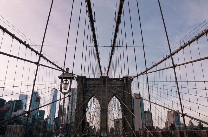 Architecture Bridge - Man Made Structure Building Exterior Built Structure Cable City Connection Day Low Angle View Modern No People Outdoors Sky Skyscraper Suspension Bridge Travel Destinations