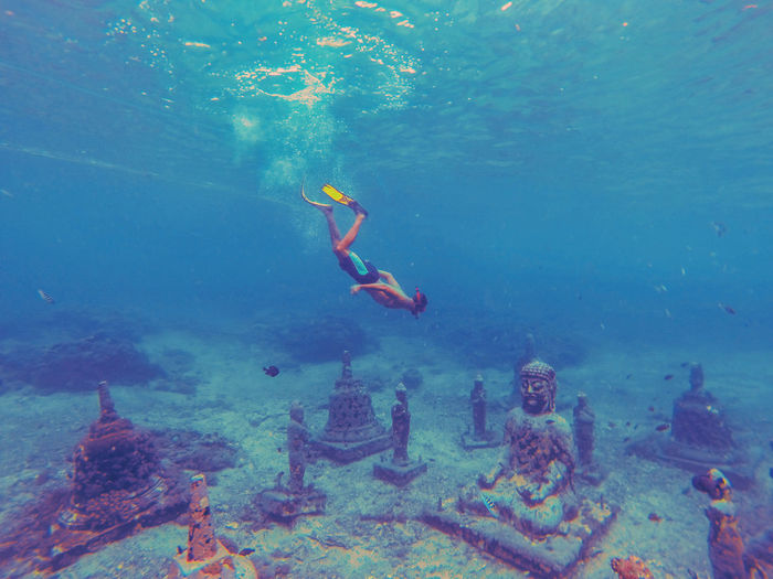 Snorkeling at the underwater buddha temple in bali.