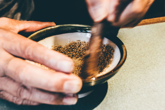 Capturing Movement Close-up Cooking Cooking Tools Cookware Crush Food Foodstuffs Grind Hand Hands At Work Japanese  Japanese Culture Japanese Style Mortar Mortar And Pestle Onthetable Part Of Pestle Pound Ready-to-eat Seasoning Sesame Still Life Table