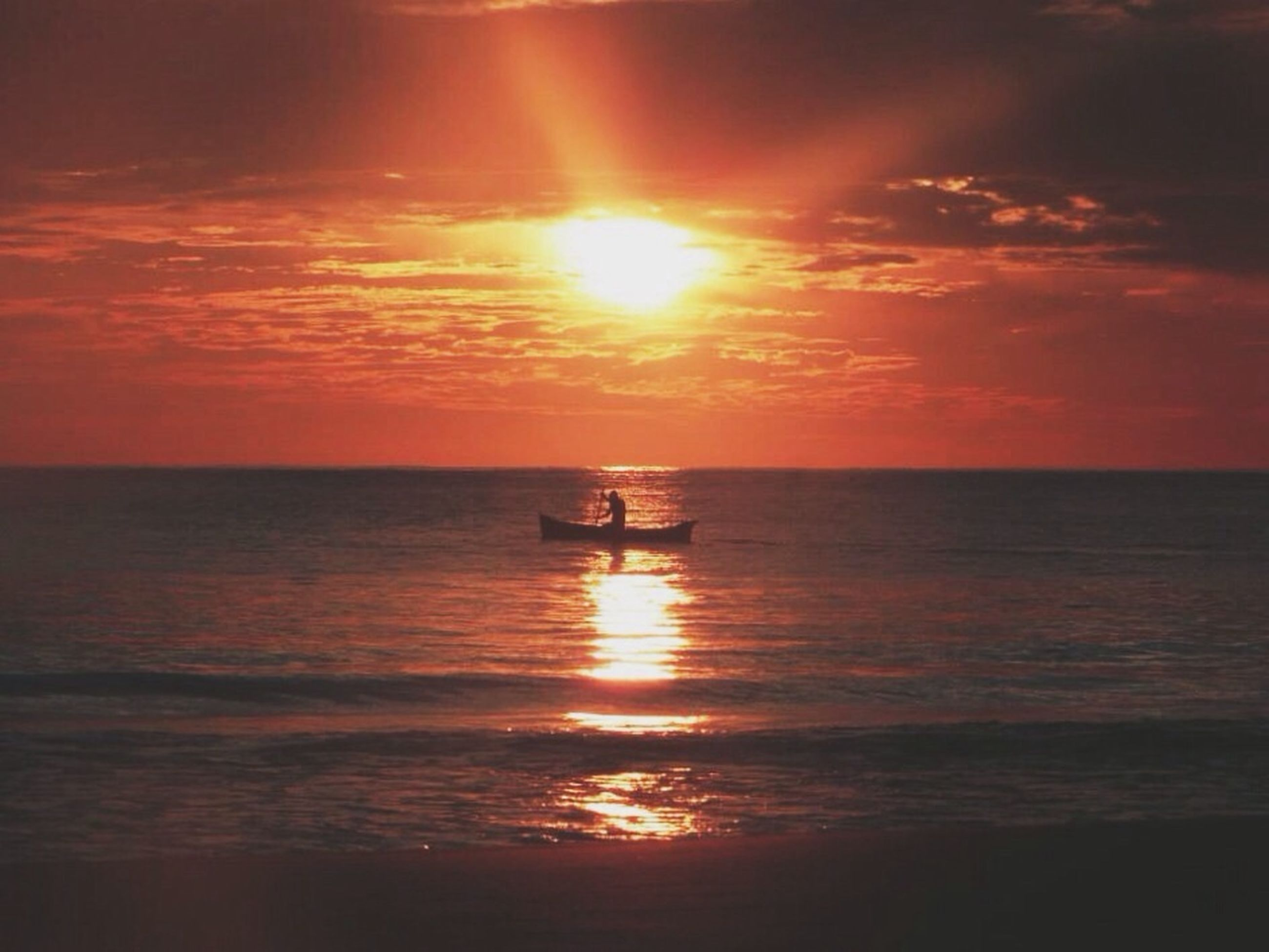 sunset, sea, water, horizon over water, sun, transportation, nautical vessel, scenics, sky, silhouette, orange color, mode of transport, beauty in nature, tranquil scene, tranquility, reflection, boat, waterfront, idyllic, nature