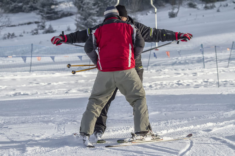 Adventure Cold Temperature Day Mountain Nature One Person One Woman Only Outdoors People Rear View Ski Goggles Ski Holiday Ski Jacket Ski Pole Ski-wear Skiing Sky Lesson Snow Snowboarding Sport Standing Vacations Warm Clothing Winter Winter Sport