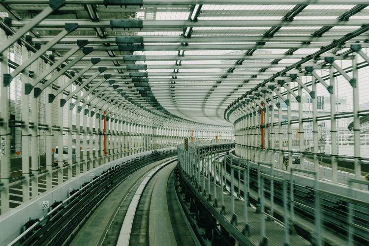 Railroad tracks seen through glass ceiling
