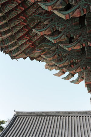 Korean traditionlal architecture Sky Architectural Feature Architecture Korea Korean Ancient Building Kyungju Korea Bulguksa Tree Roof Historic Tall Tower Buddhist Temple Architectural Detail Architecture And Art Exterior Settlement Residential Structure Tall - High Architectural Design Place Of Worship Skylight