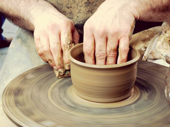 Close-Up Of Man Making A Pot