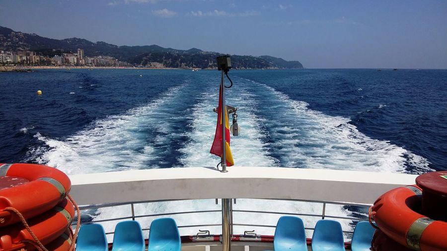 Boat sailing in sea against sky