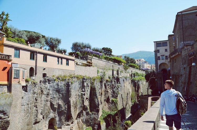 Architecture Building Exterior Built Structure Clear Sky Rear View Men Day Real People Sky Outdoors Full Length Tree Mountain Nature One Person City People Adult Let's Go. Together. Sorrento Sorrento, Italia Sorrentocoast Vacations Walking EyeEmNewHere Breathing Space Your Ticket To Europe Lost In The Landscape Be. Ready.
