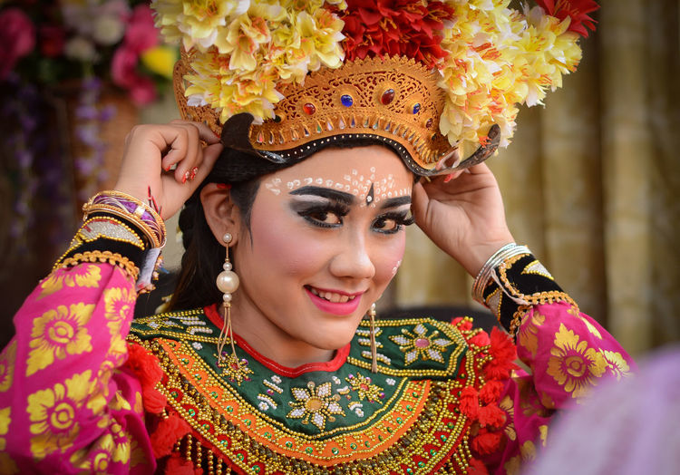 Beautiful Balinese dancer get ready for performing traditional opera called Arja. Bali Beautiful Dance INDONESIA Opéra Tabanan, Bali, Indonesia Traditional Clothing Balinese Beautiful Woman Celebration Dancer Headshot Indonesian Photographers Collection Joged Joged Bumbung Make-up Preparation  Smile Smiling Traditional Traditional Clothing Traditional Costume Traditional Dancing Women Young Adult