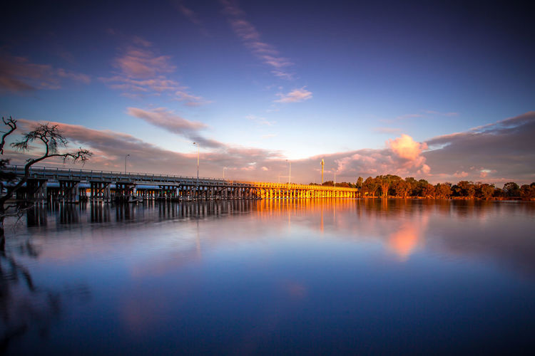 Riverside Architecture Beauty In Nature Blue Building Exterior Built Structure Cloud - Sky Day Evening Landscape Nature No People Outdoors Reflection River Scenics Sky Sunset Water Waterfront