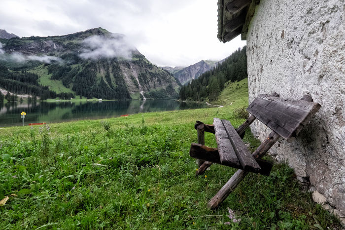 Bench Vilsalpsee Beauty In Nature Day Grass Mountain Mountain Range Nature No People Outdoors Sea Sky Water