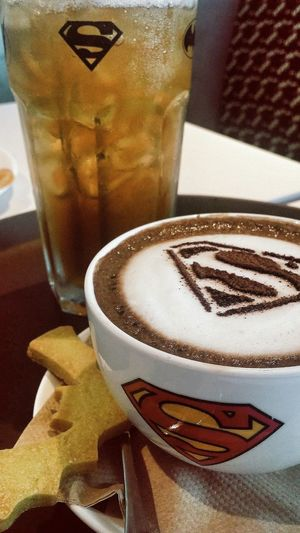 Superman's Tea Of Justice (that's mine) (there's no justice) (basically ice-lemon tea), Wonderwoman- watchamecallit Batman Biscuit Superheroes Cafe Marina Bay Sands Singapore
