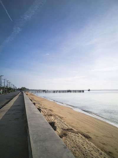 Roads and coastal erosion protection dams at thapsakae beach, prachuap khiri khan, thailand.