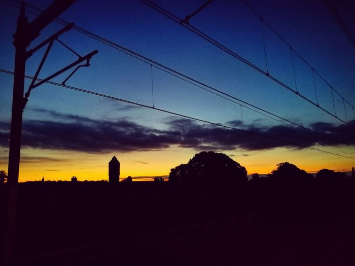 Sunrise Utrecht Zuilen Trainstation Holland Beautiful Sunlight Silhouette Blue Cable Power Line  Cloud Sky Dark Tranquil Scene Beauty In Nature Dramatic Sky No People Outdoors Nature Outline Sunset Early Morning Utrecht Zuilen 030 Mobile Photography