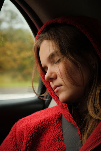 Close-up of woman relaxing in car