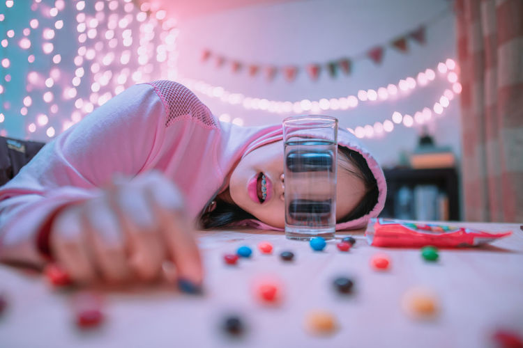 Enjoy life it's delicious.🍩🍧🍬 Leisure Activity Girls Lifestyles Indoors  Lying Down Headshot Child Innocence Childhood Portrait Selective Focus Real People Lying On Front Casual Clothing Day Celebration Candy Light Light And Shadow Lighting Equipment Color Colors Colorful Color Portrait