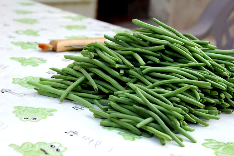 High Angle View Of Green Beans On Table