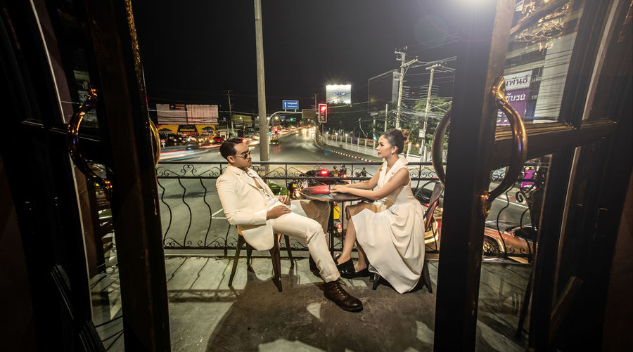People sitting in restaurant at night
