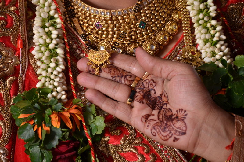 wedding photoshoot Ornaments EyeEm Selects Human Hand Celebration Jewelry Human Body Part Only Women One Woman Only Adults Only One Person Indoors  Adult Wedding Tradition Women Flower Close-up One Young Woman Only Wedding Dress Young Adult Traditional Clothing EyeEmNewHere Wedding Ceremony Groom Traditional Culture Wedding Vows Ceremony Wedding Ring Embroidery Henna Tattoo