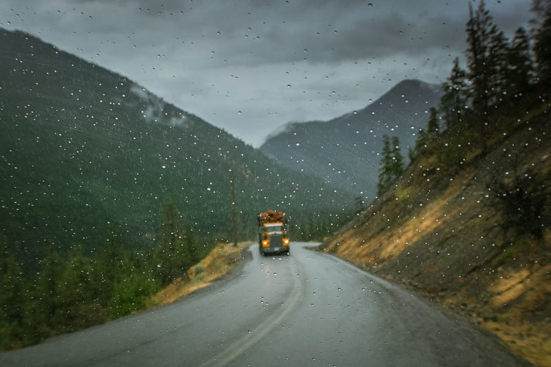 Foul weather logging British Columbia Driving In The Rain Foul Weather Gold Bridge Hauling Hazardous Conditions Logger Mountain Mountain Road Road The Way Forward Through The Window Transportation Trucking Truckinglife Weather Wet