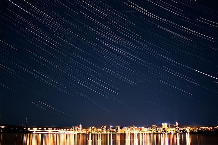 Night Star - Space Illuminated Astronomy Outdoors City Constellation Sky Scenics Sea No People Architecture Space Nature Milky Way Star Trail Astrology Sign Galaxy Lake Cold Temperature Timelapse Nature
