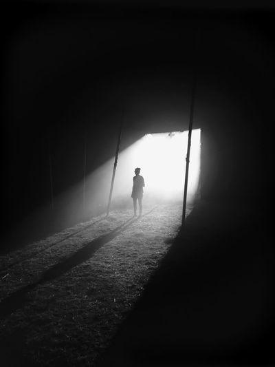 Woman standing in darkroom