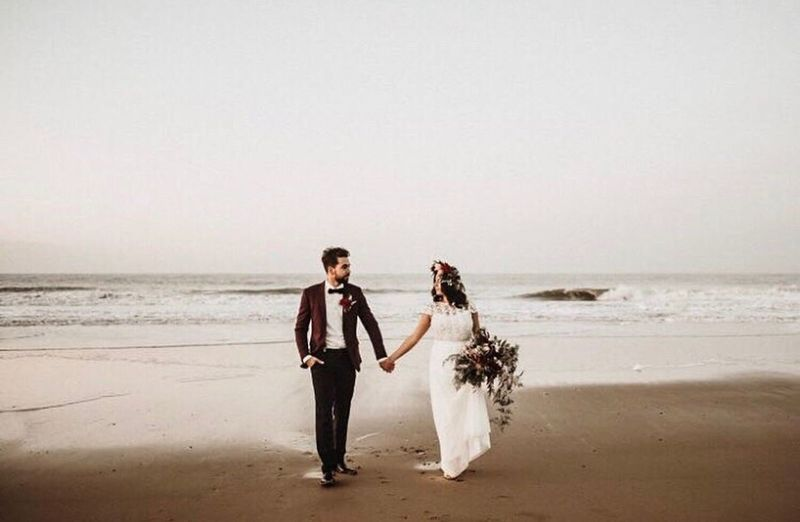 Beach Sea Wedding Bride Wedding Dress Togetherness Young Adult Adult Sand Love Well-dressed Full Length Young Women People Adults Only Bridegroom Two People Horizon Over Water Formalwear Bonding