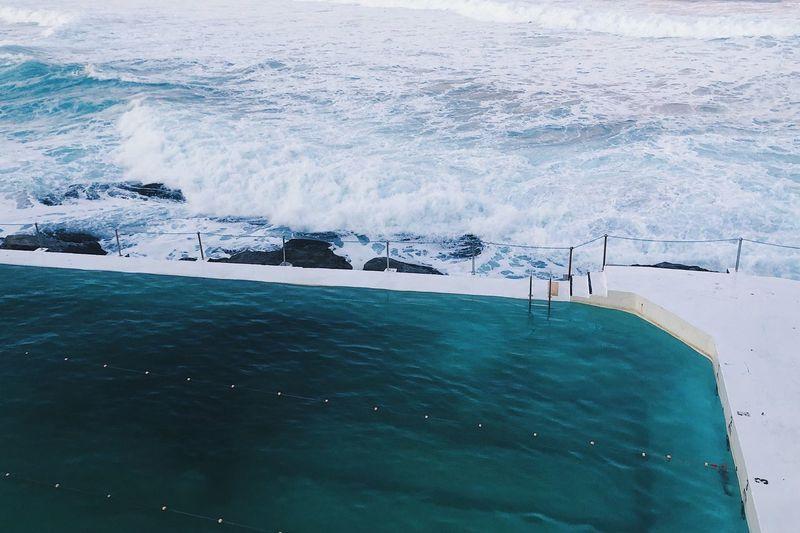 High angle view of infinity pool by sea
